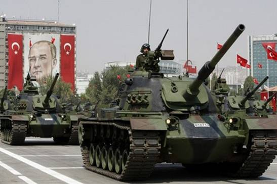 Turkish army tanks roll past a portrait of Mustafa Kemal Ataturk, founder of modern Turkey, during a military parade on the 86th anniversary of Victory Day in Ankara, August 30, 2008. Tensions between Turkey's government and its powerful generals will continue clouding the future of the European Union-applicant country, after the new military commander warned against the rising profile of Islam.   REUTERS/Fatih Saribas  (TURKEY)